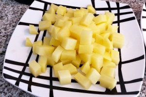 Patata cortada a cubos